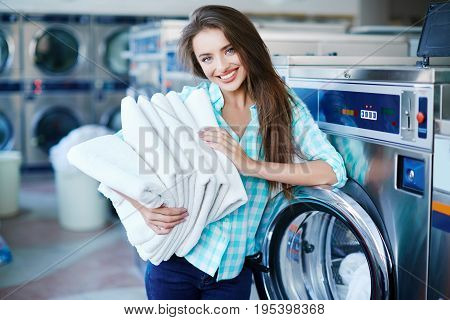 Young Girl With A Heap Of Fresh Linen