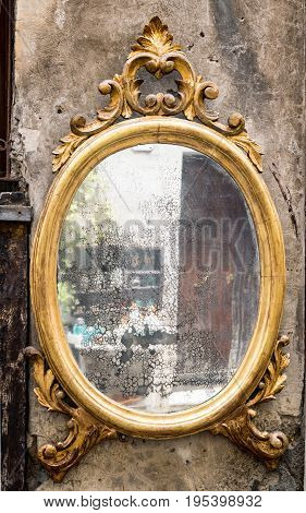 Classic antique mirror with gilded frame engraved