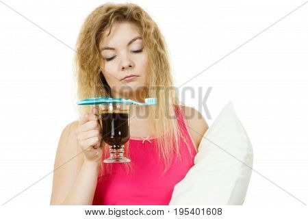 Tired Woman Holding Toothbrush And Coffee