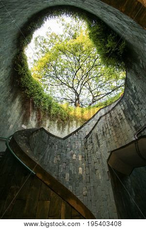 Spiral staircase of underground crossing in tunnel at Fort Canning Park, Singapore.