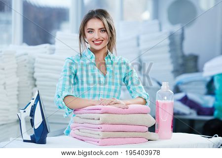 Woman Leaning On Heap Of Rose Towels
