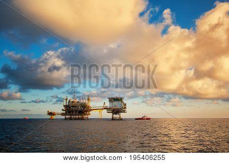 Oil and gas platform landscape during sunset time