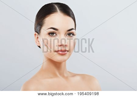 Lovely Girl With Dark Hair At Gray Studio Background
