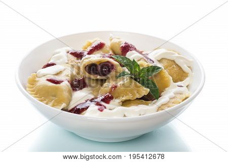 Homemade Sweet Dumplings With Berries And Sour Cream