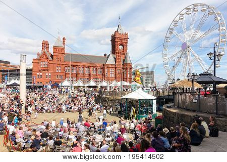 Cardiff United Kingdom - July 14 2017: People are enjoying themselves and listen to music on the opening day of the Cardiff International Food Festival 2017 at Roald Dahl Plass Cardiff Bay Cardiff Wales UK.