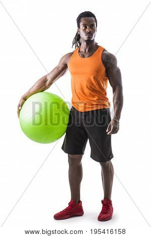 Muscular black man holding inflatable fitness ball, looking at camera, standing isolated on white background