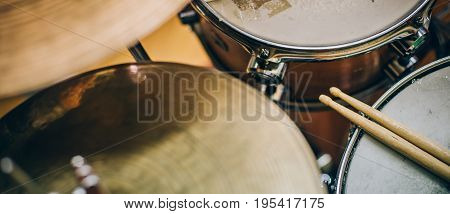 Closeup Of Drumsticks Lying On The Drum Set