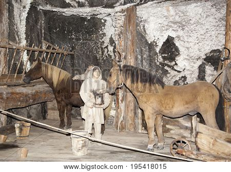 The scene showing working environment with horses inside salt mine hundred years ago (Poland).