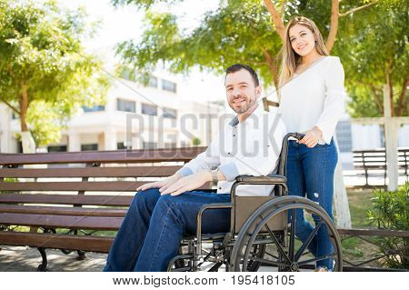Woman Pushing Man In Wheelchair