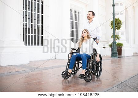 Man Pushing Woman On A Wheelchair