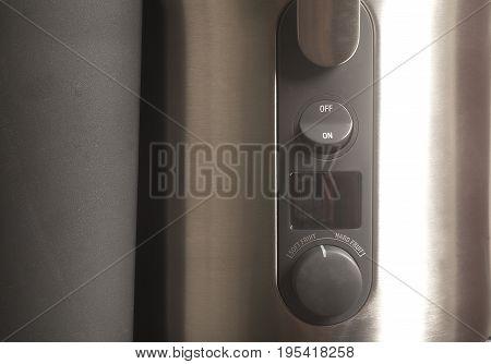 Metallic professional juicer detail close - up .