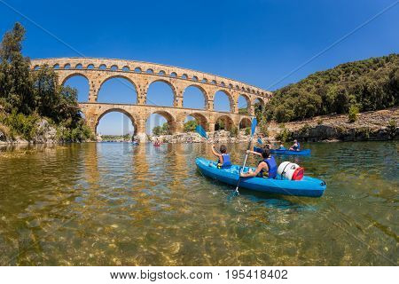 Pont du Gard with paddle boats is an old Roman aqueduct in Provence France