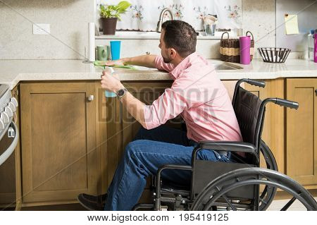 Disabled Man Cleaning His Kitchen