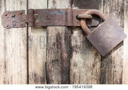 Padlock. Old rusty padlock on old wooden door