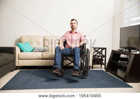 Sad Man On A Wheelchair At Home
