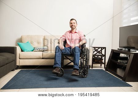 Optimistic Man On A Wheelchair At Home