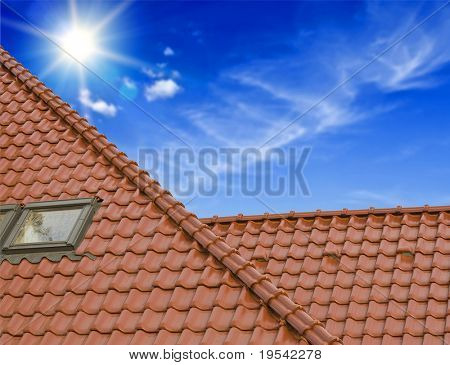 the roof of the house under the blue sky