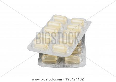 Medical pills in silver blister packs isolated on white background