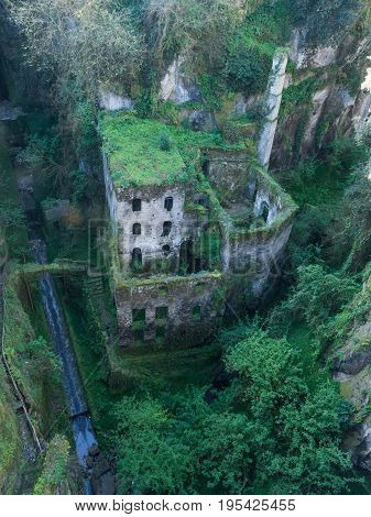 View of the ancient idyllic ruin of a mill in the valley