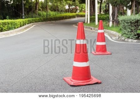 Traffic cone on the asphalt road used for road safety.