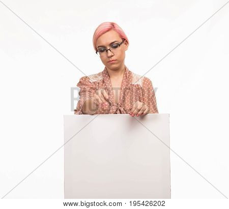 Young serious woman portrait of a confident businesswoman showing presentation, pointing placard background. Ideal for banners, registration forms, presentation, landings, presenting concept.