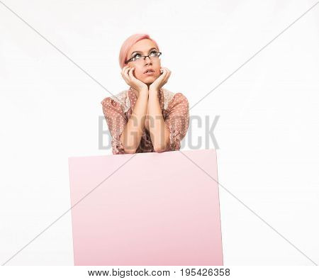 Young contemplative woman portrait of a confident businesswoman showing presentation, pointing placard background. Ideal for banners, registration forms, presentation, landings, presenting concept.