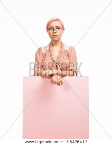 Young sad woman portrait of a confident businesswoman showing presentation, pointing placard background. Ideal for banners, registration forms, presentation, landings, presenting concept.