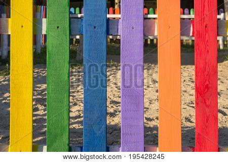 Bright multi colorful fence on children's playground