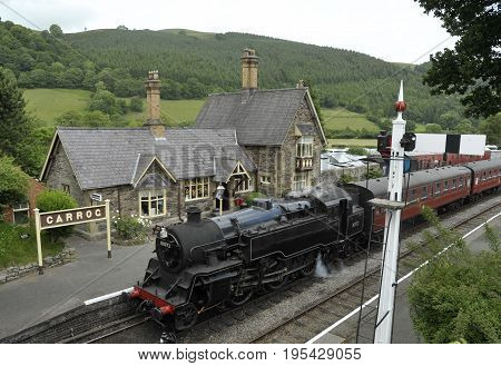 Carrog Railway Station with a standard class 4 tank engine part of the Llangollen Railway preserved heritage line in the Dee Valley Denbighshire Wales UK.