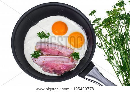 Fried eggs and bacon in frying pan on white background. Studio Photo