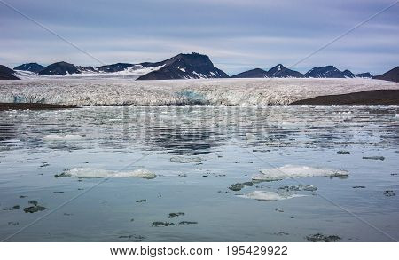 Small icebergs in front of a glacier Svalbard