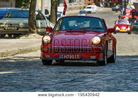 Lviv Ukraine - June 4 2017:Old retro car Porsche 911 with its owner and an unknown passenger taking participation in race Leopolis grand prix 2017 Ukraine.
