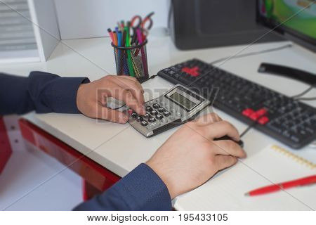 Close up view of bookkeeper or financial inspector hands making report calculating or checking balance. Home finances investment economy saving money or insurance concept
