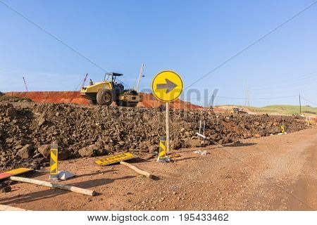 Construction industrial earthworks landfill compactor machine vibration leveling sand stones landscape
