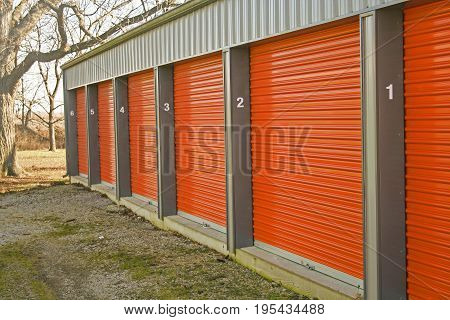 A row of self storage units with over head style doors.