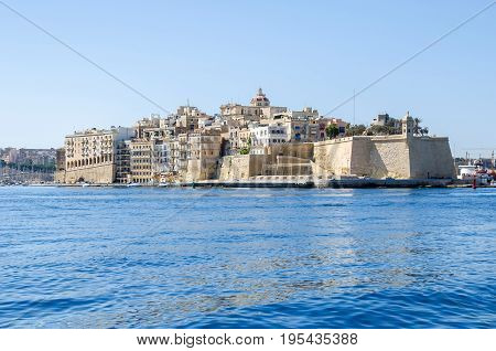 The view of Senglea peninsula from Grand Harbour with Fort Saint Michael and the Guard tower on the tip of the bastions and the St. Philip's Chapel dome. Malta