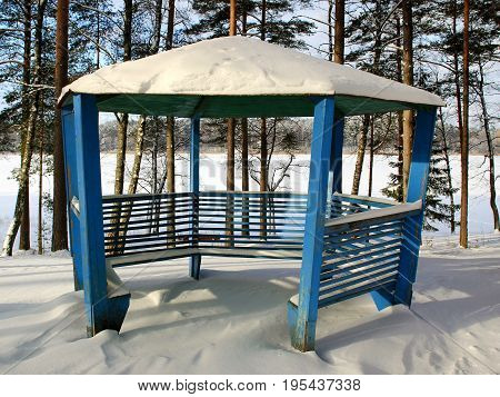 The wooden pavilion in the winter park