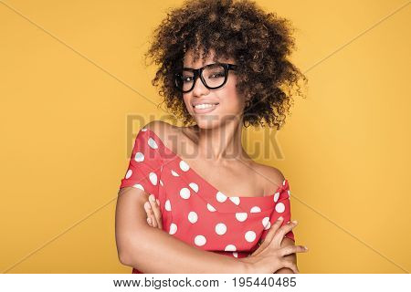 African American Girl In Eyeglasses On Yellow Background.