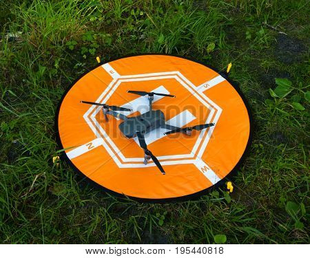 Quadcopter at the landing pad on the grass
