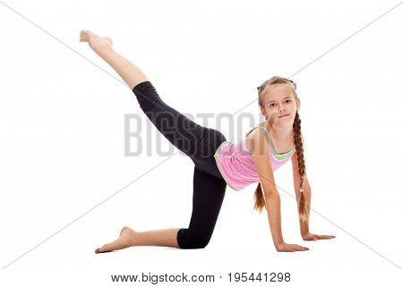 Young girl doing gymnastic exercises, side view, isolated