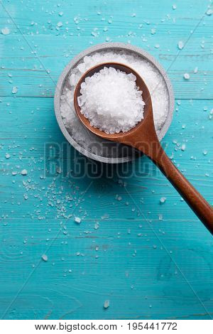 sea salt in stone bowl and wooden spoon