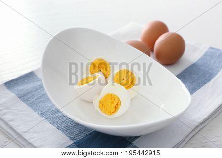 Tasty hard boiled eggs on plate. Nutrition concept