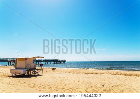White rescue hut on a sandy beach safe relax by the ocean a beautiful sunny day vacation