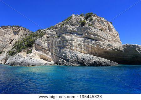 Keri caves on Zakynthos island. Blue sea and rocks on sunny day in Greece.