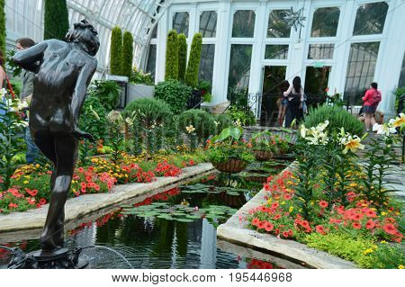SAINT PAUL, MINNESOTA- JUNE 2017:  Summer flower show in the Sunken Garden at Como Zoo and Conservatory in St. Paul, MN.
