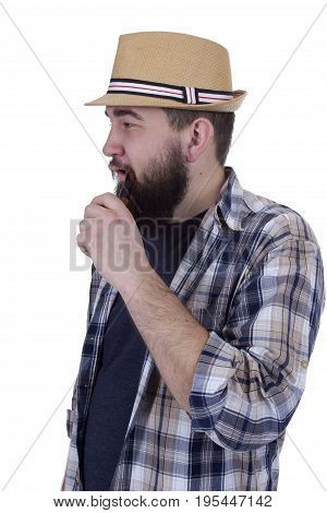 Handsome hipster smocking a pipe on a white background