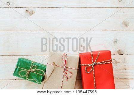 Christmas background with decorations and handmade gift boxes on white wooden board with copy space. vintage filter effect