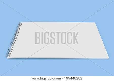 Blank White Notebook With Metal Spiral Bound On Blue Background