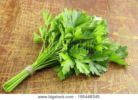 Fresh parsley on wood background, tasty, natural