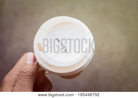 hand holding coffee cup with label expiration